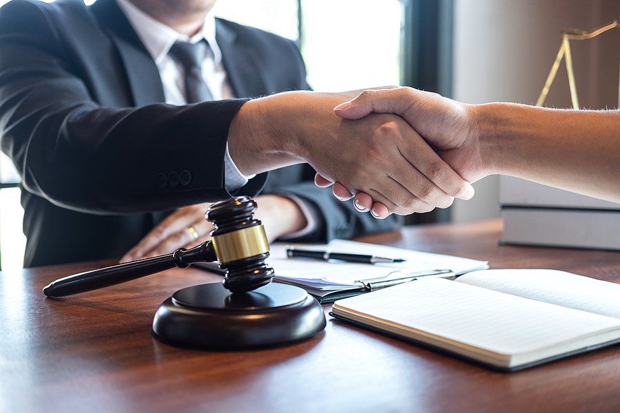Family law specialist meeting and handshaking his client